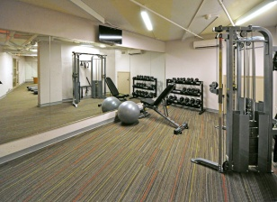 A dedicated free weight and strength machine room.