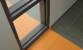 Vivid orange tile is non-slip and durable.