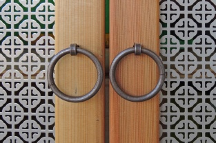 Wrought iron ring pulls.